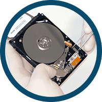 Image of a hard drive surrounded by a blue circle